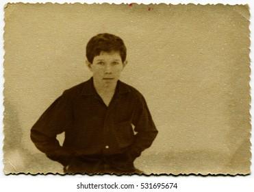Ussr - CIRCA 1970s: An antique Black & White photo show portrait of a boy