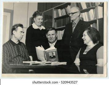 USSR - CIRCA 1970s: An antique photo shows people sit in the library. The inscription on the book by L.I. Brezhnev