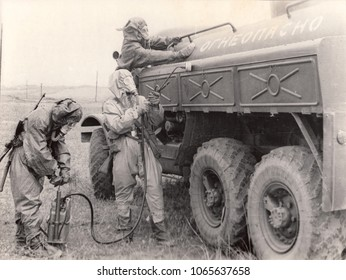 USSR - CIRCA 1970s : Retro photo shows Chemical troops of the USSR.Soviet soldiers carried out the decontamination of the fuel truck from radiation or chemical contamination.
