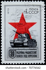 USSR - CIRCA 1973: A post  stamp printed in USSR shows tank T-34, red star and map, devoted 30 years of Kursk Battle, circa 1973