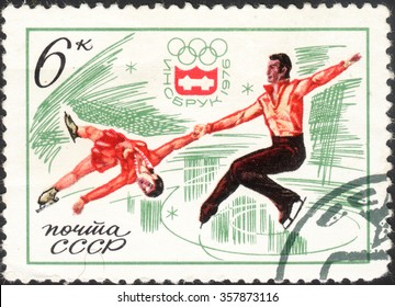 "USSR - CIRCA 1976: a post stamp printed in the USSR shows figure skaters, the series ""Winter Olympic Games - Innsbruck, Austria"", circa 1976"