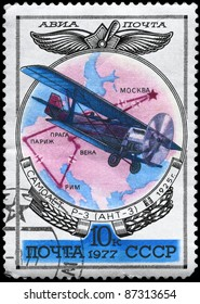 """USSR - CIRCA 1977: A Stamp printed in USSR shows the Aviation Emblem and P-3 (ANT-3) biplane (1925), from the series """"Aviation 1917-1930"""", circa 1977"""