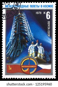 """USSR - CIRCA 1978: A Stamp printed in USSR (Russia) shows cooperation USSR and Czechoslovakia into space, with inscriptions and name of series """"International Flights in the Space"""", circa 1978"""