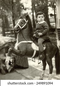 USSR - CIRCA 1978s: Vintage photo of little Girl with toy horse, USSR, 1978s