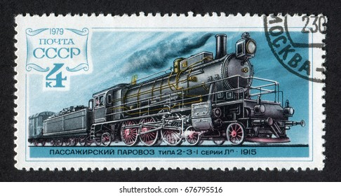 USSR - CIRCA 1979. A post stamp, printed in Russia (Soviet Union) shows steam passenger train locomotive type 2-3-I Series L released at 1915. CIRCA 1979.