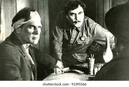 "USSR - CIRCA 1980: Soviet postcard shows Scene from the movie ""Virgin Soil Upturned"". Mosfilm, 1965. Directed by A.Ivanov.In the role of Davydov - Petr Chernov, Nagulnov - Yevgeny Matveyev, circa 1980"
