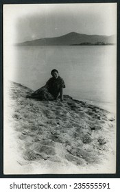 Ussr - CIRCA 1980s: An antique Black & White photo show woman at the lake