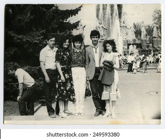 Ussr - CIRCA 1980s: An antique Black & White photo show a group of tourists on a background of Fantan