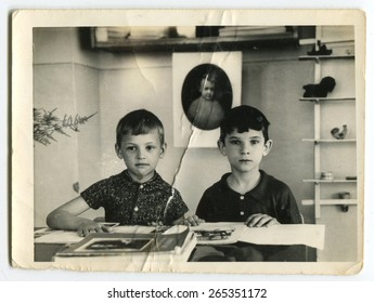 Ussr - CIRCA 1980s: An antique Black & White photo show two boys sitting at the desk