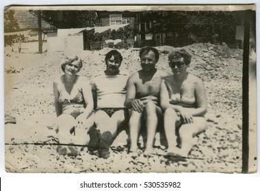 Ussr - CIRCA 1980s: An antique Black & White photo show family portrait at the beach
