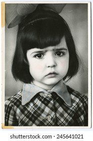 USSR - CIRCA 1980s: An antique photo show little girl with a bow on her head