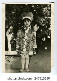 USSR - CIRCA 1980s: An antique photo shows little girl near Christmas tree, circa 1980s