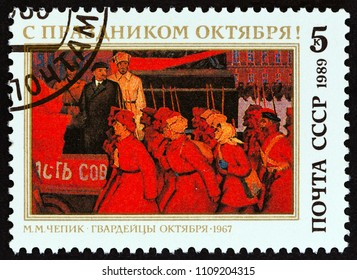USSR - CIRCA 1989: A stamp printed in USSR issued for the 72th Anniversary of Great October Revolution shows October Guardsmen by M. M. Chepik, 1967, circa 1989.