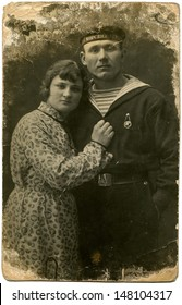 USSR - CIRCA1935 : Vintage photo shows sailor with girl, 1935