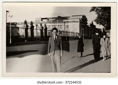 USSR - FEBRUARY 29, 1952: Vintage photo shows a young man poses on the street. Black & white retro photo.