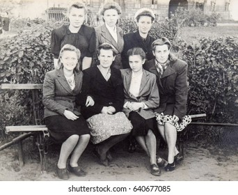 USSR, LENINGRAD - CIRCA 1946: Vintage photo of group of young pretty girls on park bench in Leningrad, USSR