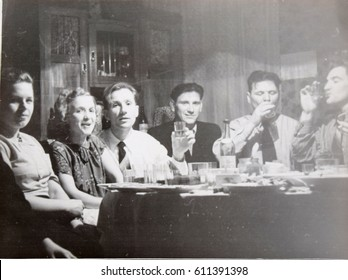 USSR, LENINGRAD - CIRCA 1952: Vintage photo of feast of young friends in Leningrad, USSR