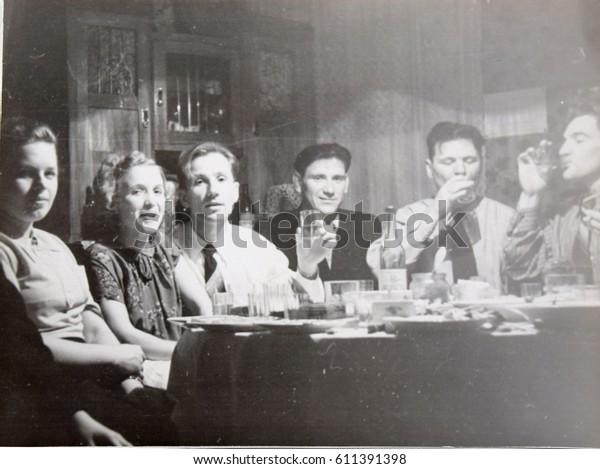 USSR, LENINGRAD - CIRCA 1952: Vintage photo of feast of young friends in Leningrad, USSR
