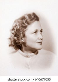 USSR, LENINGRAD - CIRCA 1955: Vintage photo of young pretty woman portrait in Leningrad, USSR