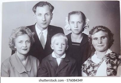 USSR, LENINGRAD - CIRCA 1963: Vintage photo of happy soviet family in Leningrad, USSR