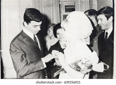 USSR, LENINGRAD - CIRCA 1969: Vintage photo of wedding couple. Just married couple. Soviet bride and groom wedding in Leningrad, USSR