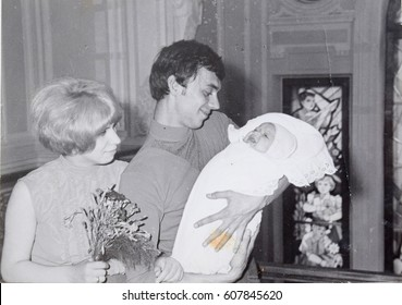 USSR, LENINGRAD - CIRCA 1970: Vintage photo of happy young parents with newborn girl in Leningrad, USSR