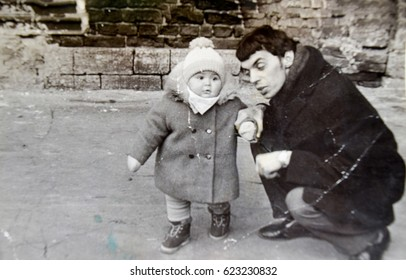 USSR, LENINGRAD - CIRCA 1970: Vintage photo of happy young dad with toddler girl daughter in Leningrad, USSR