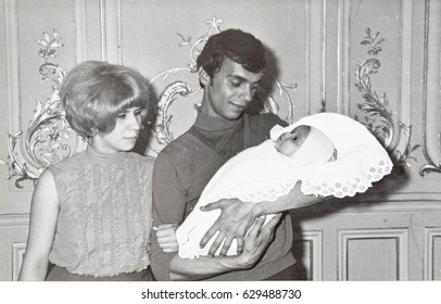 USSR, LENINGRAD  - CIRCA 1970: Vintage photo of young parents with newborn daughter portrait in Leningrad, USSR