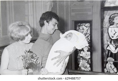 USSR, LENINGRAD  - CIRCA 1970: Vintage photo of young parents with newborn daughter  in Leningrad, USSR