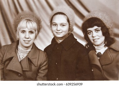 USSR, LENINGRAD - CIRCA 1970: Vintage photo of three young women smiling portrait in Leningrad, USSR