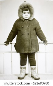 USSR, LENINGRAD - CIRCA 1972: Vintage photo of little girl standing in winter clothes in Leningrad, USSR