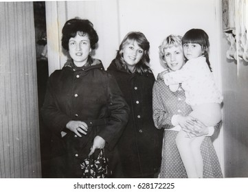 USSR, LENINGRAD - CIRCA 1972: Vintage photo of young mom with little daughter and her friends in Leningrad, USSR