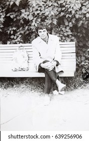 USSR, LENINGRAD - CIRCA 1973: Vintage photo of young man sitting on park bench in Leningrad, USSR