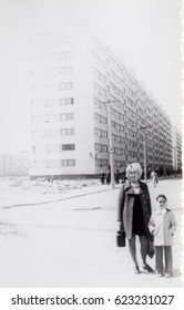 USSR, LENINGRAD - CIRCA 1974: Vintage photo of young mother with little daughter standing at new house in Leningrad, USSR
