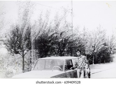USSR, LENINGRAD - CIRCA 1974: Vintage photo of young man at own LADA car in Leningrad, USSR