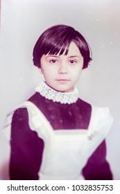 USSR, LENINGRAD - CIRCA 1977: Vintage photo of cute soviet little school girl portrait in Leningrad, USSR