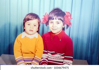 USSR, LENINGRAD - CIRCA 1978: Vintage photo of little sister with little brother together portrait in Leningrad, USSR