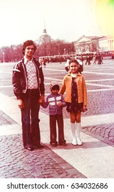 USSR, LENINGRAD - CIRCA 1978: Vintage photo of young father with kids on Palace Square in Leningrad, USSR