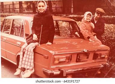 USSR, LENINGRAD - CIRCA 1980: Vintage photo of family soviet car trip in Leningrad, USSR