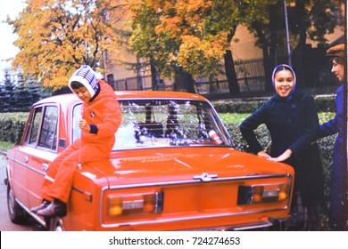 USSR, LENINGRAD - CIRCA 1980: Vintage photo of happy soviet family on autumn car trip in Leningrad, USSR