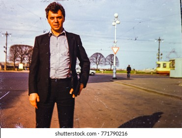 USSR, LENINGRAD - CIRCA 1980: Vintage photo of attractive fashionable man on spring street in Leningrad, USSR