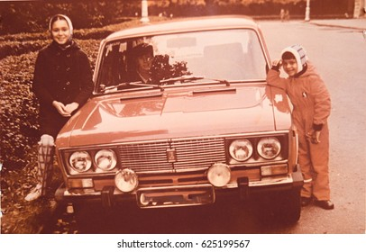 USSR, LENINGRAD - CIRCA 1981: Vintage photo of children at own family red soviet car Zhiguli Lada in Leningrad, USSR
