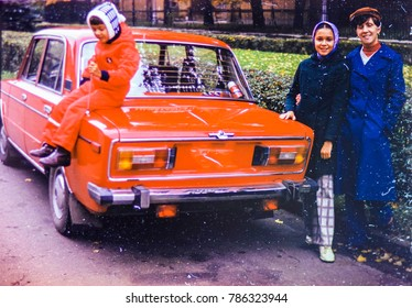 USSR, LENINGRAD - CIRCA 1981: Vintage photo of family car trip in autumn city in Leningrad, USSR