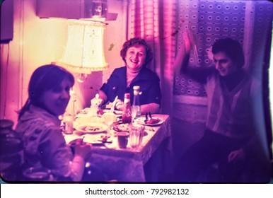 USSR, LENINGRAD - CIRCA 1981: Vintage photo of family dinner kitchen table at home in Leningrad, USSR