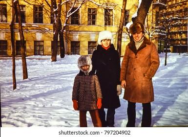 USSR, LENINGRAD - CIRCA 1981: Vintage photo of father with children on winter walk in Leningrad, USSR
