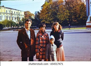 USSR, LENINGRAD - CIRCA 1982: Vintage photo of soviet family on walk in Leningrad, USSR