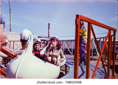 USSR, LENINGRAD - CIRCA 1982: Vintage photo of mom with little son in Luna attraction park in Leningrad, USSR