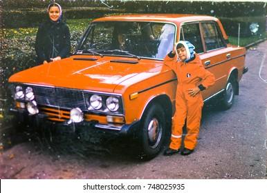 USSR, LENINGRAD - CIRCA 1982: Vintage photo of kids at family soviet car Zhiguli Lada posing in Leningrad, USSR