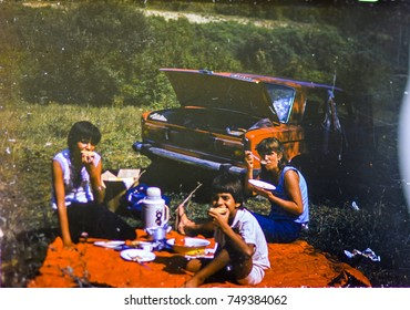 USSR, LENINGRAD - CIRCA 1983: Vintage photo of family car trip vacation picnic scene in USSR