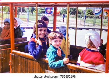 USSR, LENINGRAD - CIRCA 1983: Vintage photo of kids in trammie in attraction park in Leningrad, USSR